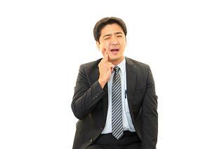 man mouth pain loose dental bridge