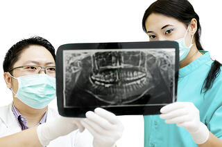 bigstock-Dentist-And-Assistant-Checking-35884303-2