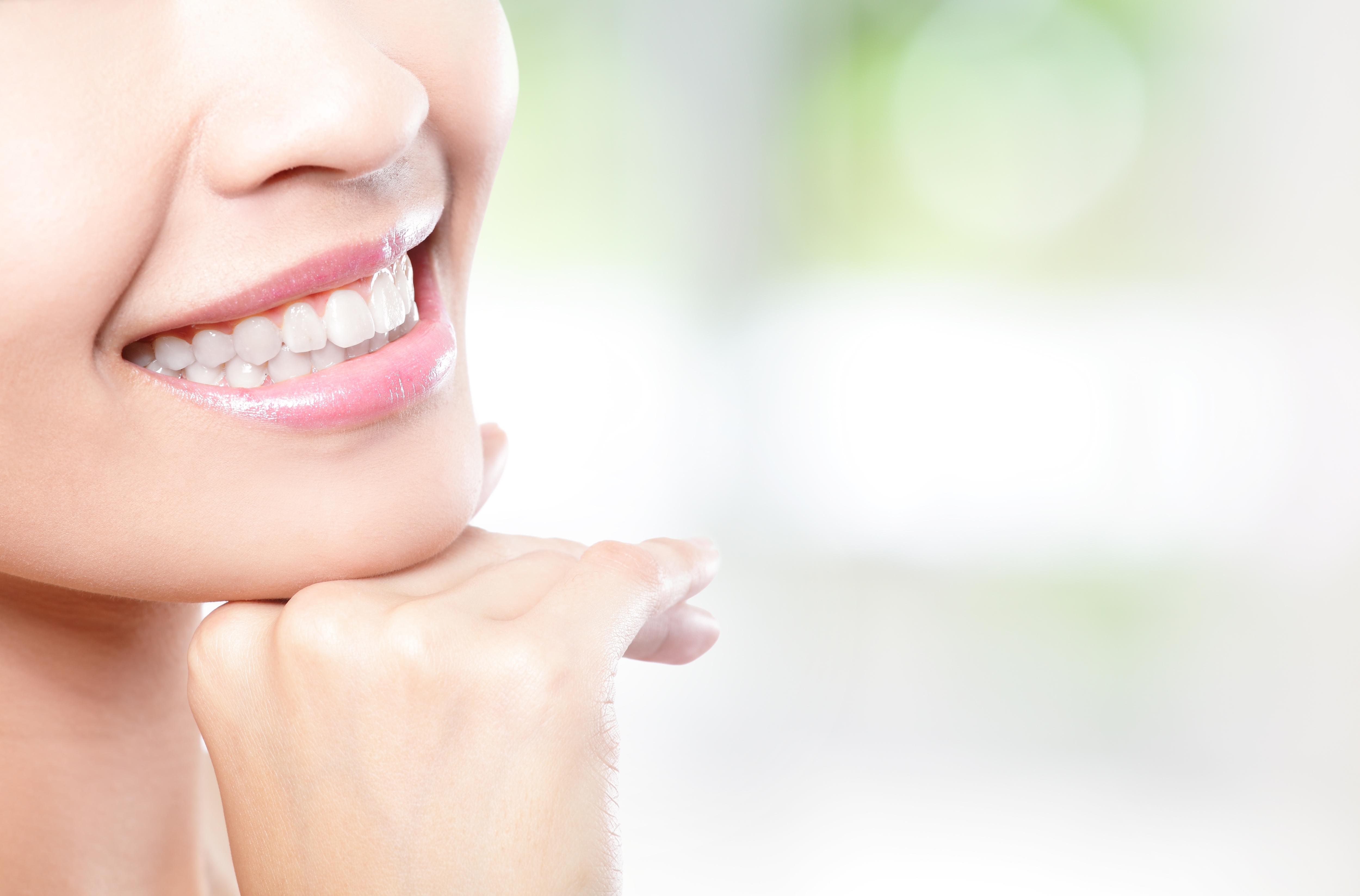 bigstock-Beautiful-Young-Woman-Teeth-Cl-49719305.jpg