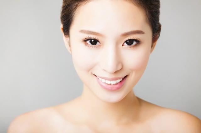 bigstock-Closeup-Smiling-Young-Asian-W-84454724.jpg