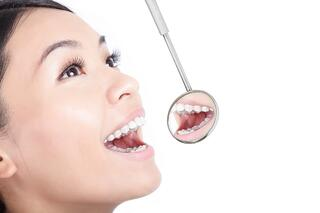 bigstock-Healthy-Woman-Teeth-With-A-Den-51046225.jpg