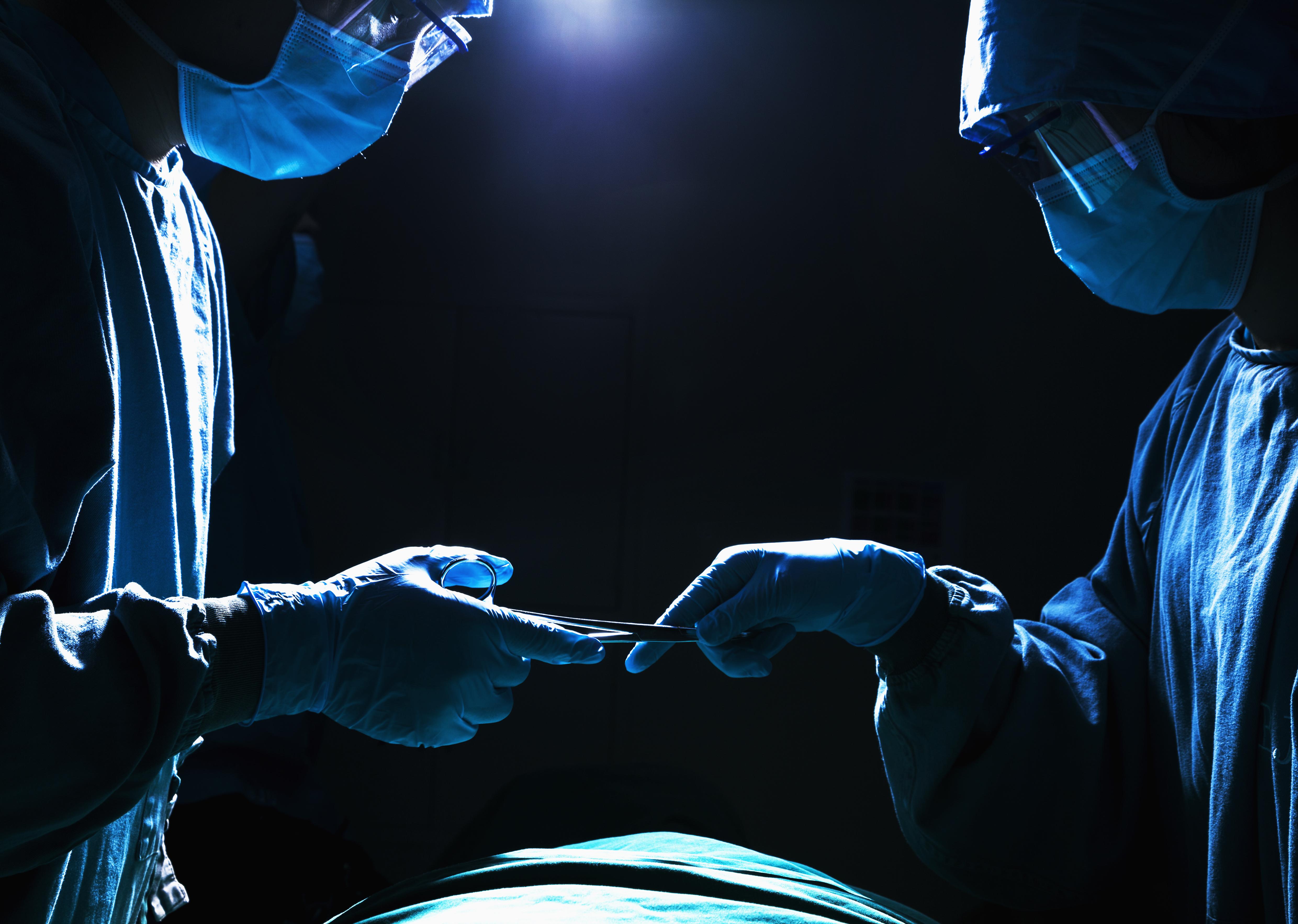 bigstock-Two-surgeons-working-and-passi-52318804.jpg