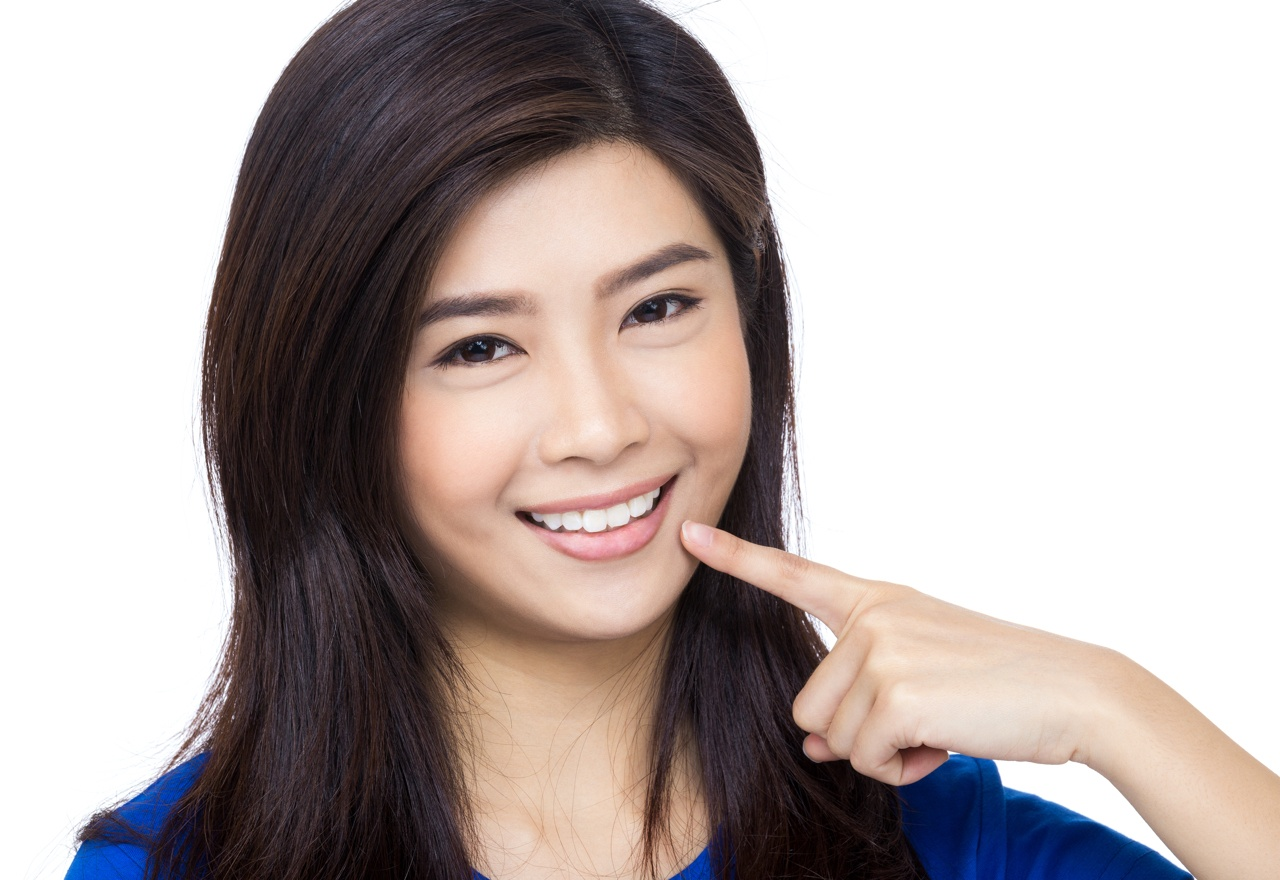 bigstock-Asia-woman-pointing-to-her-mou-61614584.jpg