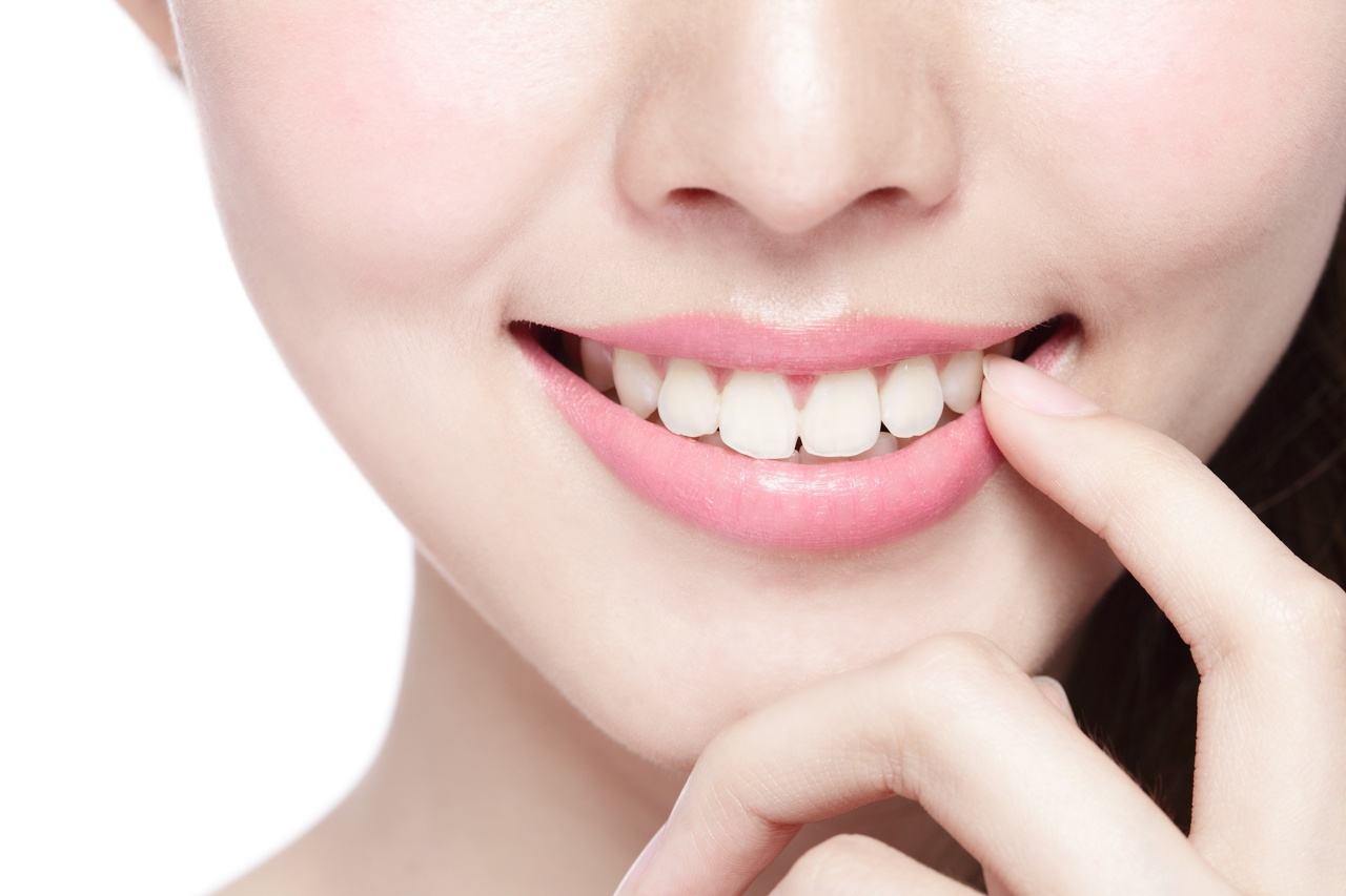 perfectly aligned teeth in a young woman